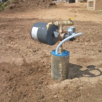 An over the top discharge system for residential irrigation